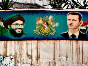 A poster of Nasrallah with Bashar Al Assad seen on a wall in Damascus.