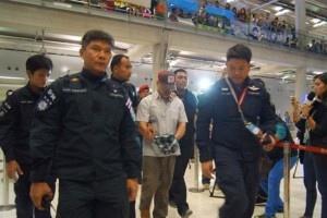 Ramin Pakneiad, a key suspect in a passport forgery case, escorted by Thai police after being extradited from Malaysia.Bangkok Post