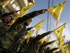 Lebanon's Hezbollah members carry Hezbollah flags.