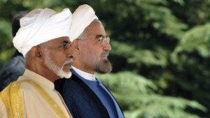 Iran's President Hasan Rouhani, right, and Omani Sultan Qaboos, listen to their countries national anthems in an official arrival ceremony for Sultan Qaboos, in Tehran Aug. 25, 2013.  (AP)