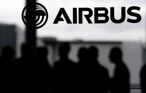 People are seen in silhouette behind the logo of Airbus during the Airbus A350-1000 maiden flight event in Colomiers near Toulouse, Southwestern France, November 24, 2016.  (Reuters)