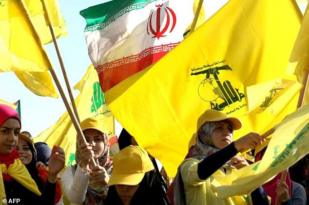 Lebanese Hezbollah supporters raise Iranian flag in response to Beirut Port accusation