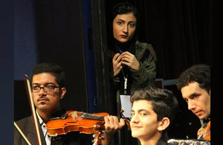 At Tehran symphony, music lovers seek escape from reality