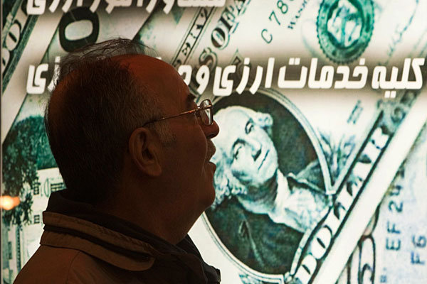 Iranian currency takes big hit, falling to new record low