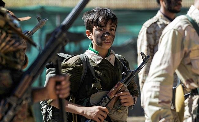 Iran-backed Houthis entice child soldiers with keys to 'enter paradise' when they die