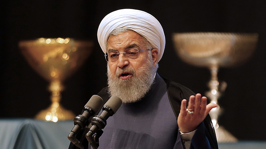 Rouhani: Iran to continue to scale back nuclear commitments