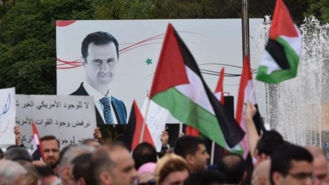 Iran's President Hassan Rouhani congratulates Syria's Assad on election victory