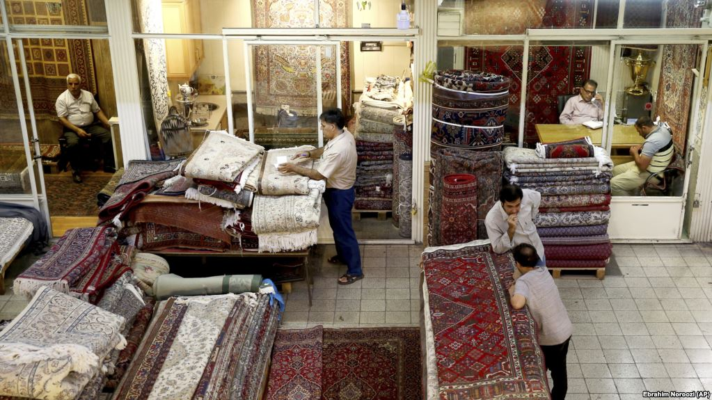 As Iran's exports drop, pressure rises on its currency reserves