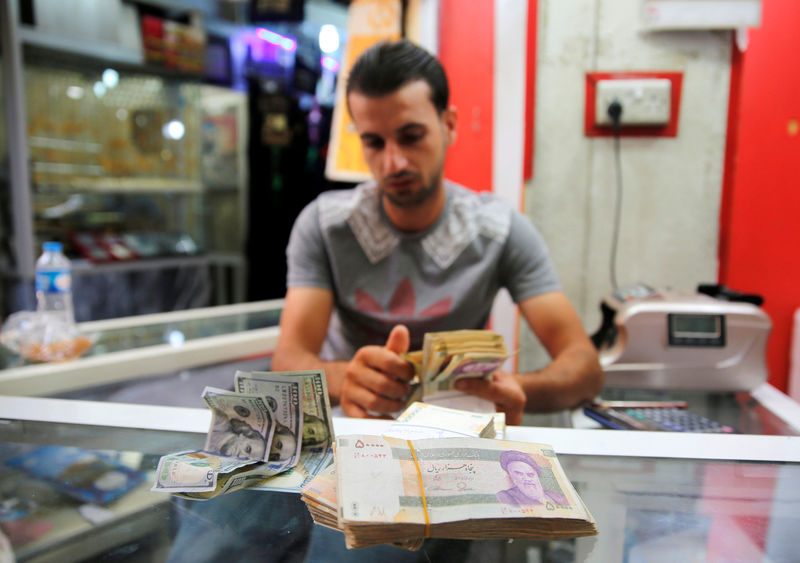 Not cashing in: virus hits Iraq's Iran-US money trade