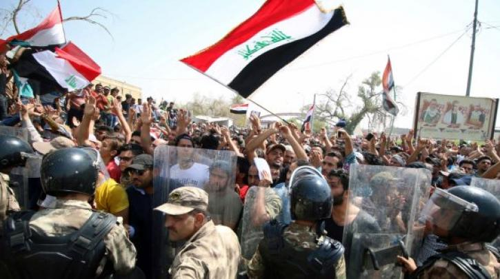 Iraq protests descend into bloodshed as activists say Iran making them 'strangers in our country'