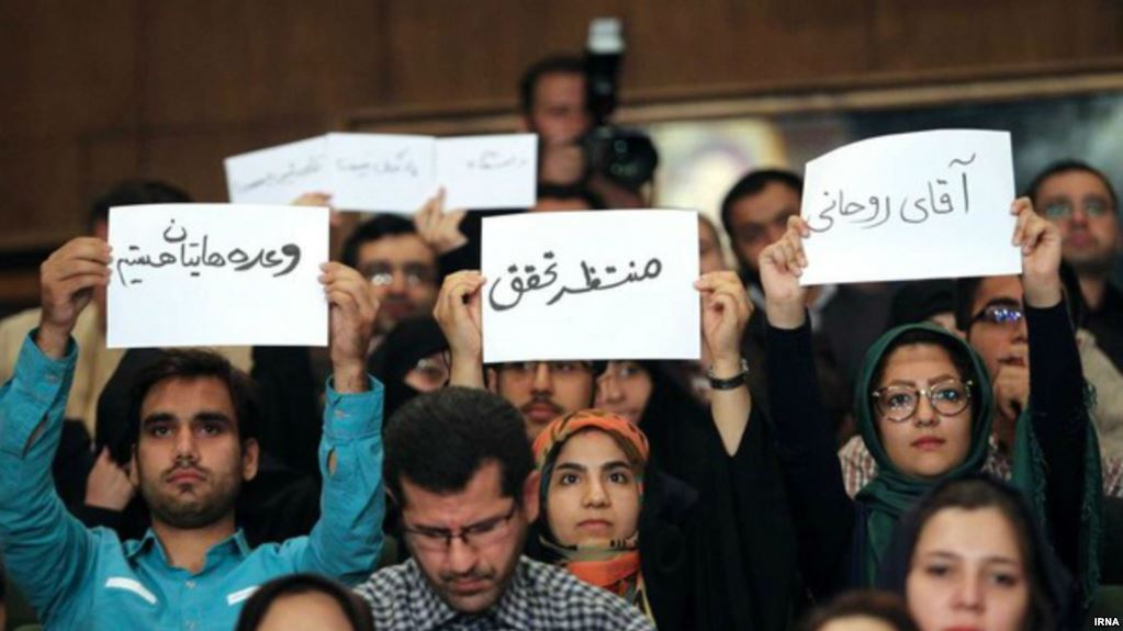 Students tell Rouhani 'thunder of military boots' being heard across Iran