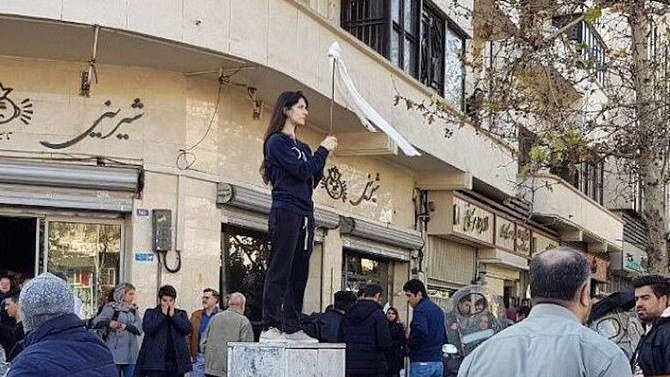 Iranian who removed headscarf sentenced to year in prison