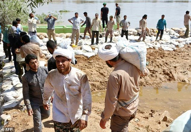 Iran closes oil wells in flood-hit Khuzestan province, output drops