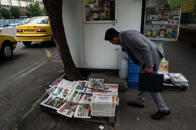 Iran shutters newspaper after expert questions virus numbers