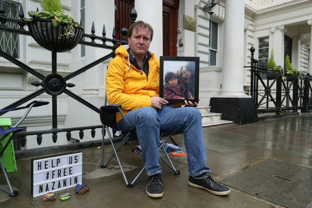 She's on a hunger strike in an Iranian jail. He's joining in, from London