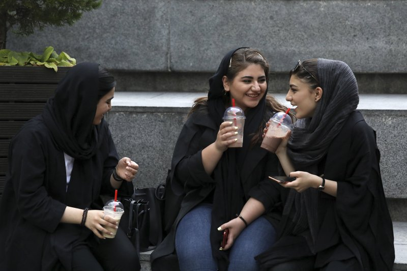 Some Iranian women take off their hijabs as hard-liners push back