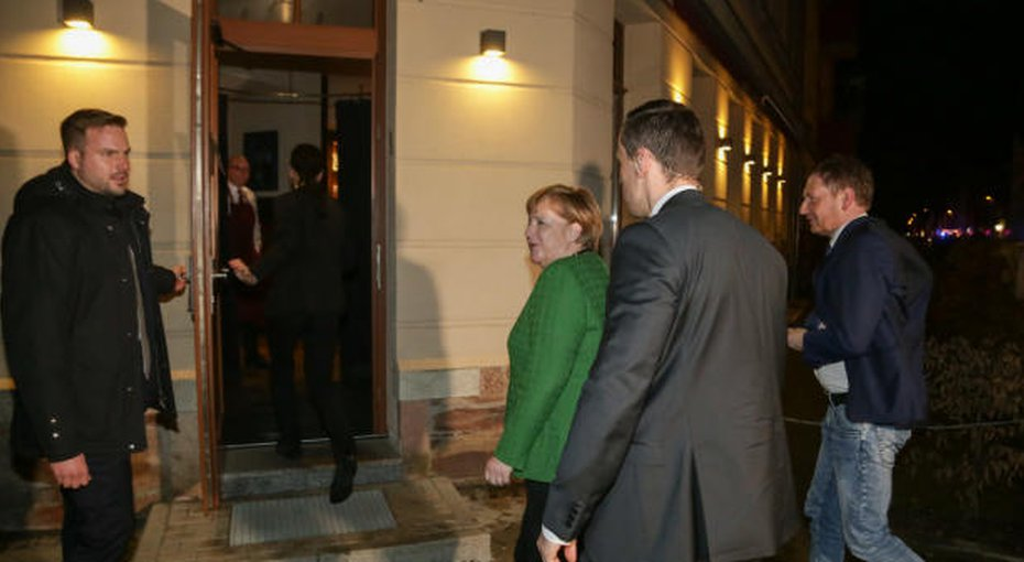 Angela Merkel's visit to a Persian restaurant to console an Iranian victim of neo-Nazis