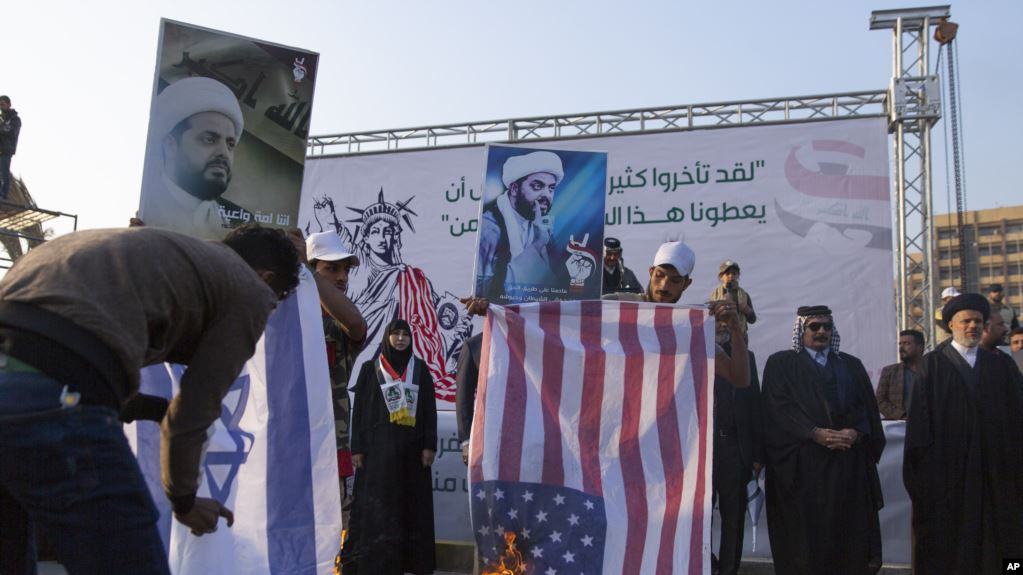 Iraqi supporters of pro-Iran group protest U.S. sanctions