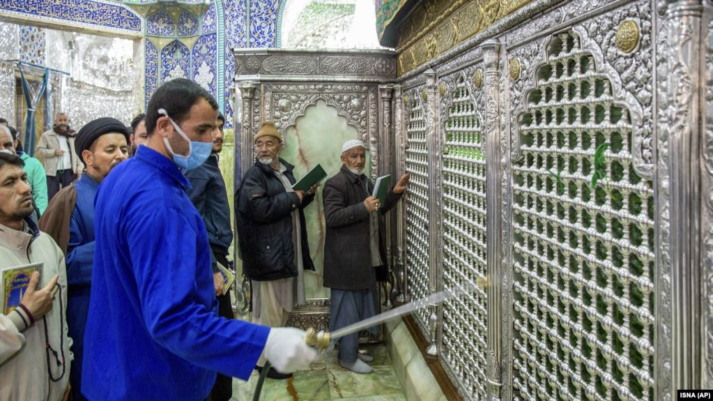 Iranian clerics keep shrines open, even as virus spreads