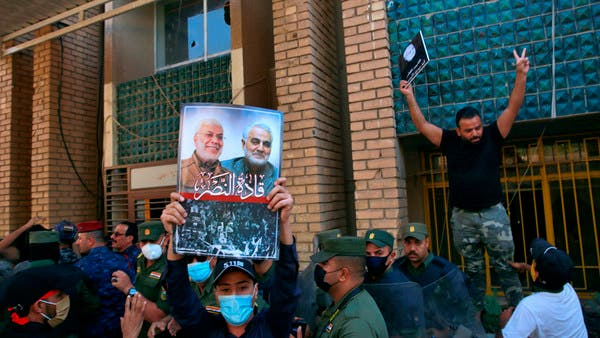 Carrying Soleimani posters, pro-Iran protesters torch Kurd party offices in Iraq