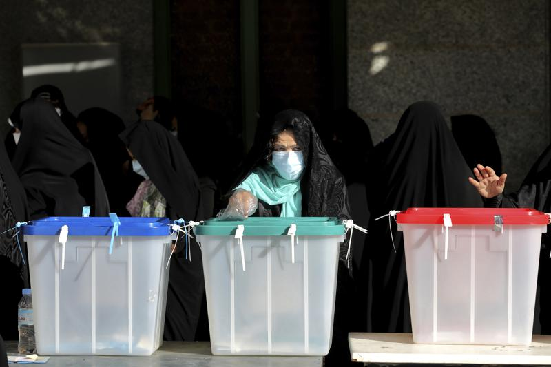 Iran votes in presidential poll tipped in hard-liner's favor