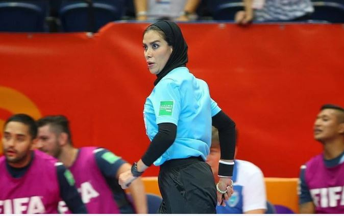 Iranian star referee defies ban and shines again at international competition
